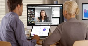 Black business manager remotely talking to employees